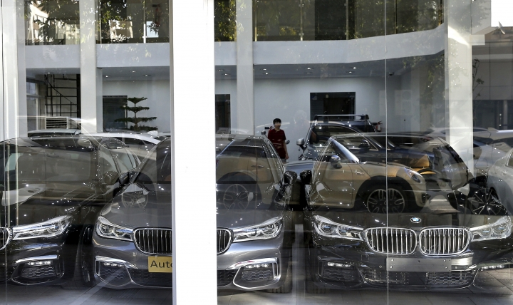In this Monday, Sept. 17, 2018 photo, imported cars are displayed at a showroom in Tehran, Iran. As Iran's rial currency suffers precipitous falls against the U.S. dollar, cars are growing more and more expensive. Meanwhile, foreign manufacturers are pulling out from the country and foreign-produced parts are becoming harder to find. (AP Photo/Ebrahim Noroozi)