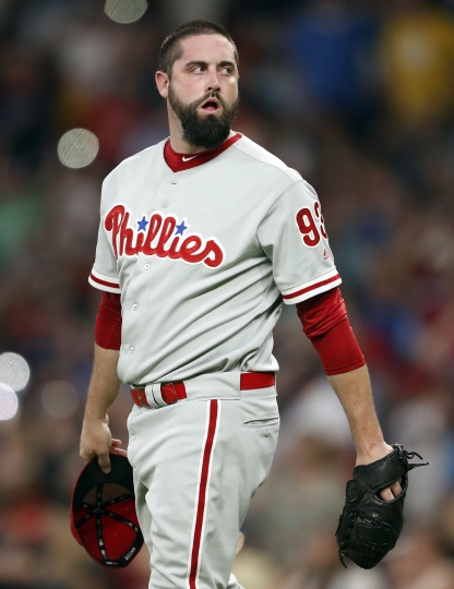 Philadelphia Phillies relief pitcher Pat Neshek walks back to the mound between Atlanta Braves batters during the seventh inning of a baseball game Friday, Sept. 21, 2018, in Atlanta. (AP Photo/John Bazemore)
