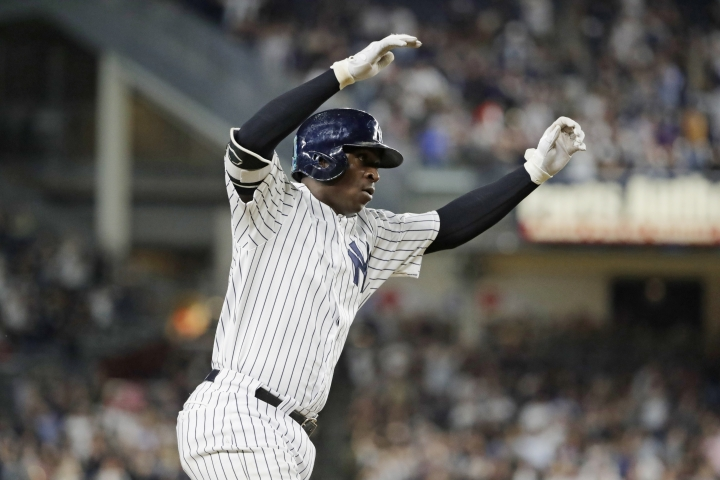 New York Yankees' Didi Gregorius celebrates as he runs the bases after hitting a home run during the first inning of a baseball game against the Baltimore Orioles, Friday, Sept. 21, 2018, in New York. (AP Photo/Frank Franklin II)