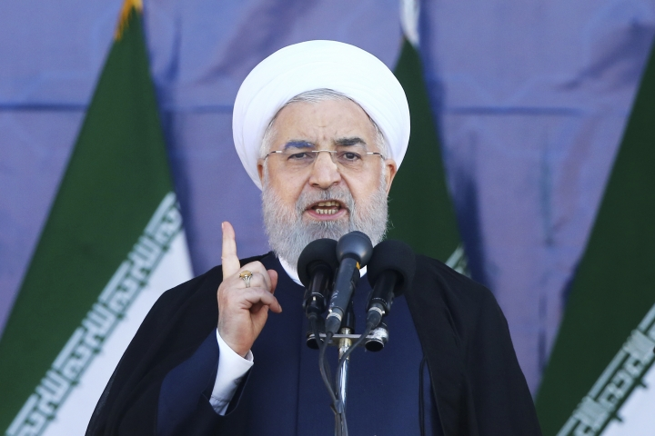 Iran's President Hassan Rouhani speaks at a military parade marking the 38th anniversary of Iraq's 1980 invasion of Iran, in front of the shrine of the late revolutionary founder, Ayatollah Khomeini, outside Tehran, Iran, Saturday, Sept. 22, 2018. Gunmen attacked the military parade, killing at least eight members of the elite Revolutionary Guard and wounding 20 others, state media said. (AP Photo/Ebrahim Noroozi)