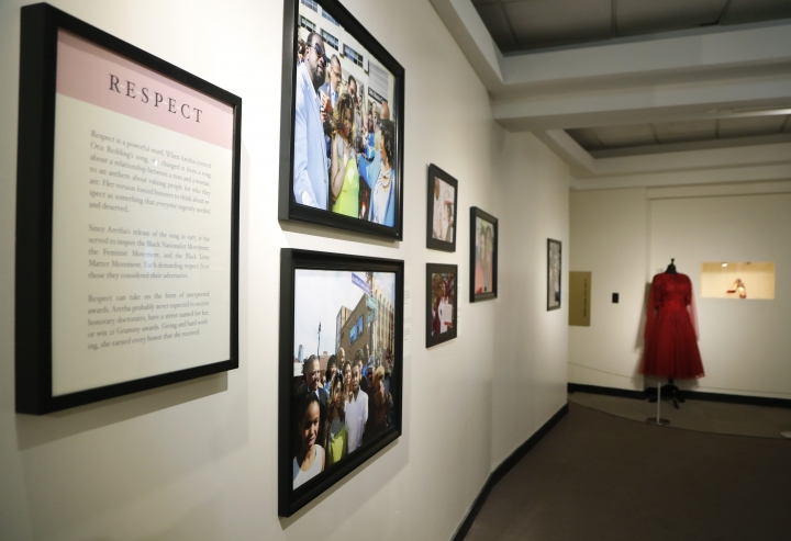 """In a photo from Friday, Sept. 21, 2018, in Detroit, an exhibit at the Charles H. Wright Museum of African American History features a """"tribute to the Queen of Soul."""" """"THINK"""" opens to the public Tuesday at the museum that hosted Aretha Franklin's public visitations after her death last month. It features archival photographs, videos and the red shoes she wore at her first visitation that drew global attention. (AP Photo/Carlos Osorio)"""