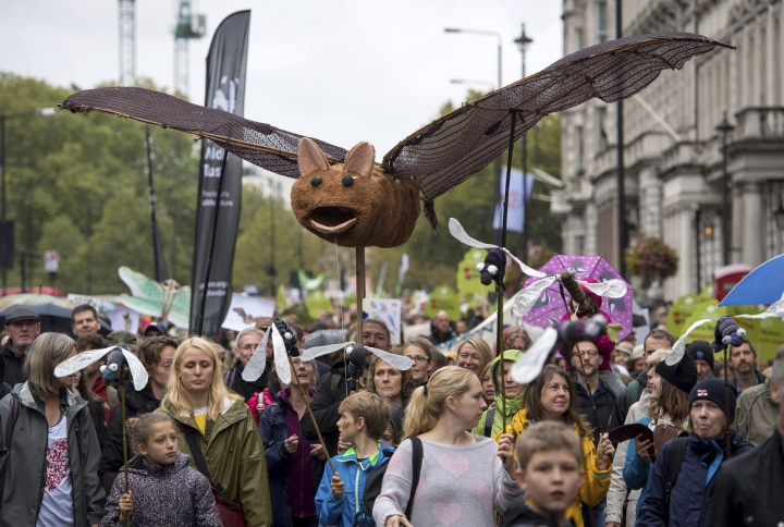 People gather during the People's Walk for Wildlife in central London, Saturday Sept. 22, 2018. Some hundreds of people gathered in London to demand better protection for the country's wildlife, with many carrying banners in support of various pro-nature and pro-animal causes. (Dominic Lipinski/PA via AP)
