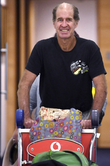 Australian filmmaker James Ricketson arrives at Sydney International Airport, Sunday, Sept. 23, 2018. Ricketson arrived two days after his 15-month stint in a Phnom Penh prison ended with clemency granted by Cambodian King Norodom Sihamoni. (Dean Lewins/AAP Image via AP)