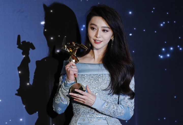 FILE - In this March 21, 2017, file photo, Chinese actress Fan Bingbing poses after winning the Best Actress Award of the Asian Film Awards in Hong Kong. Fan Bingbing, one of China's best-known starlets and a rising Hollywood star, has well and truly fallen off the map amid vague allegations of tax shenanigans and possibly other infractions that have put her at odds with China's Communist Party-appointed culture czars. (AP Photo/Kin Cheung, File)