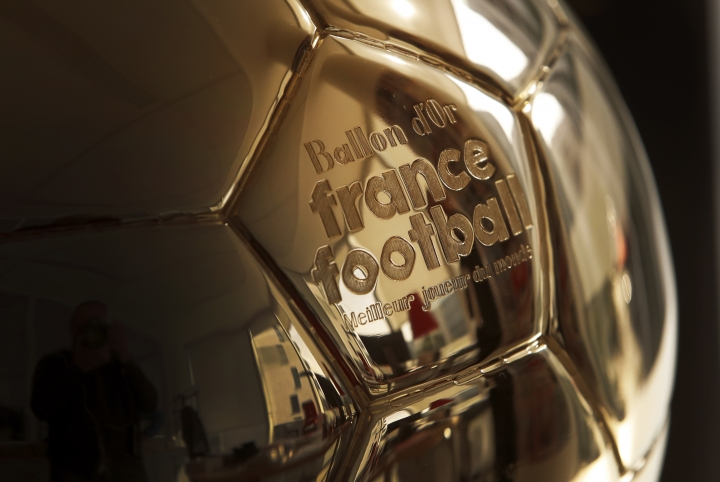 The Golden Ball is pictured in Boulogne-Billancourt, outside Paris, Friday, Sept. 21, 2018. A woman will lift the most prestigious individual trophy in soccer for the first time this year. Awarded every year by France Football magazine since Stanley Matthews won it in 1956, the Ballon d'Or for the best player of the year will be given to both a woman and a man on Dec. 3 in Paris. (AP Photo/Christophe Ena)