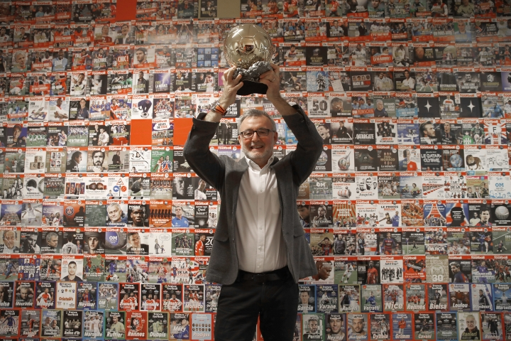 France Football magazine chief editor Pascal Ferre poses with the Golden Ball during a interview with Associated Press in Boulogne-Billancourt, outside Paris, Friday, Sept. 21, 2018. A woman will lift the most prestigious individual trophy in soccer for the first time this year. Awarded every year by France Football magazine since Stanley Matthews won it in 1956, the Ballon d'Or for the best player of the year will be given to both a woman and a man on Dec. 3 in Paris.(AP Photo/Christophe Ena)