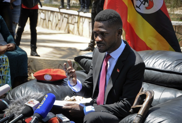 Pop star turned opposition lawmaker Bobi Wine, whose real name is Kyagulanyi Ssentamu, speaks with the media at his house in Kampala, Uganda Monday, Sept. 24, 2018. Wine says he is concerned about his safety four days after returning home from the United States, where he sought medical care for injuries sustained during alleged state torture. (AP Photo/Ronald Kabuubi)