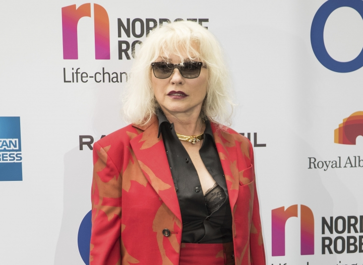 FILE - In this June 30, 2017 file photo, musician Debbie Harry of Blondie arrives at the Silver Clef Awards in London. Blondie will be playing two nights in Cuba next March as part of a four-day cultural exchange program. The iconic rock group announced Monday that they will play two concerts during their March 14-18 visit in Havana, which will also feature Cuban musicians Alain Perez, David Torrens and Sintesis. (Photo by Vianney Le Caer/Invision/AP, File)