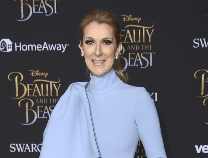 "FILE - In this March 2, 2017 file photo, Celine Dion arrives at the world premiere of ""Beauty and the Beast"" in Los Angeles. Dion has announced she will end her Las Vegas residency next year. The singer announced on social media Monday, Sept. 24, 2018, that she will leave Caesars Palace in June 2019. (Photo by Jordan Strauss/Invision/AP, File)"