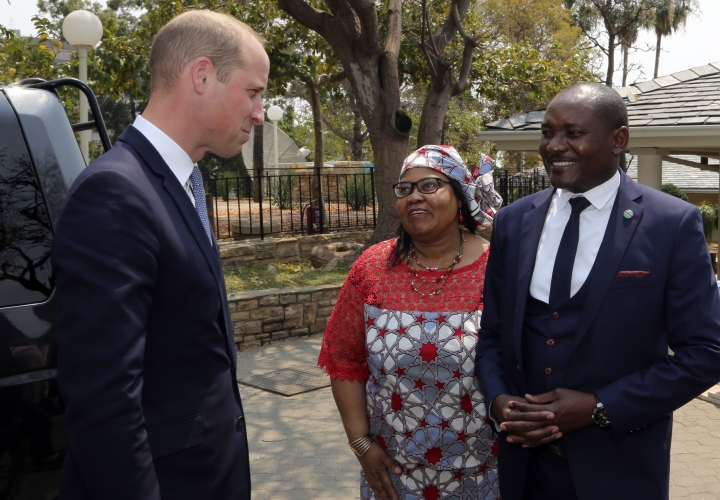 Britain's Prince William, left, talks with Namibia's Deputy Minister of Environment and Tourism, Bernadette Jagger, center, and the Minister for Environment and Tourism, Pohamba Shifeta, right, at the old State House in Windhoek, Namibia, Monday Sept. 24, 2018. The prince is on a two day visit to the southern African state with the focus being on the illegal wildlife trade as an organized crime, building coalitions and closing down markets for illicit wildlife products. (AP Photo/Dirk Heinrich)