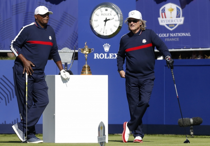 Actors Samuel L Jackson, left, and Kurt Russell of the US stand on the 1st tee before starting the Ryder Cup Celebrity Challenge match at Le Golf National in Saint-Quentin-en-Yvelines, outside Paris, France, Tuesday, Sept. 25, 2018. The 42nd Ryder Cup will be held in France from Sept. 28-30, 2018 at Le Golf National. (AP Photo/Alastair Grant)