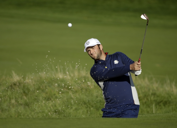 Europe's Jon Rahm plays from a bunker near the 10th green during a practice round at Le Golf National in Guyancourt, outside Paris, France, Tuesday, Sept. 25, 2018. The 42nd Ryder Cup will be held in France from Sept. 28-30, 2018 at Le Golf National. (AP Photo/Matt Dunham)