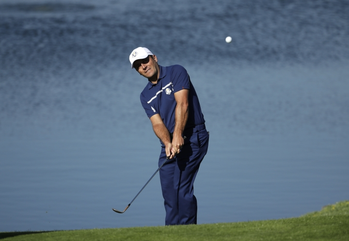 Europe's Francesco Molinari chips onto the 11th green during a practice round at Le Golf National in Guyancourt, outside Paris, France, Tuesday, Sept. 25, 2018. The 42nd Ryder Cup will be held in France from Sept. 28-30, 2018 at Le Golf National. (AP Photo/Matt Dunham)