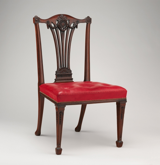 """This photo provided by The Metropolitan Museum of Art shows a Side chair from the workshop of Thomas Chippendale. The chair is featured in the exhibit """"Chippendale's Director: The Designs and Legacy of a Furniture Maker,"""" which runs through Jan. 27, 2019, at the museum in New York. (The Metropolitan Museum of Art via AP)"""