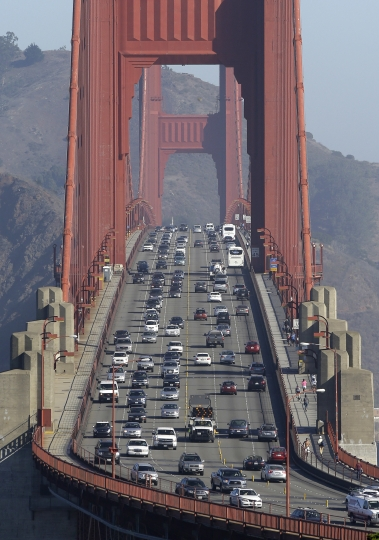 FILE - In this Sept. 19, 2013 file photo, automobile traffic flows over the Golden Gate Bridge in San Francisco. Doctors and California officials will be among those weighing in on the Trump administration's proposal to roll back car-mileage standards at a hearing Monday, Sept. 24, 2018, in a region with some of the nation's worst air pollution. The proposal would freeze U.S. mileage standards at levels mandated by the Obama administration for 2020 instead of letting them rise to 36 miles per gallon by 2025. (AP Photo/Eric Risberg, File)