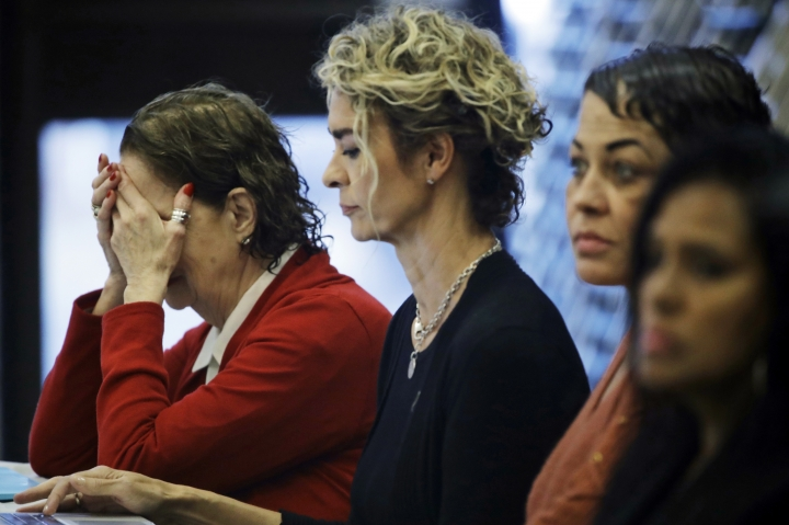 Sunni Welles, left, accompanied by Stacey Pinkerton, and Chelan Lasha, reacts during a news conference, Tuesday, Sept. 25, 2018, in Norristown Pa., after Bill Cosby was sentenced to three-to 10-years for sexual assault. (AP Photo/Matt Rourke)