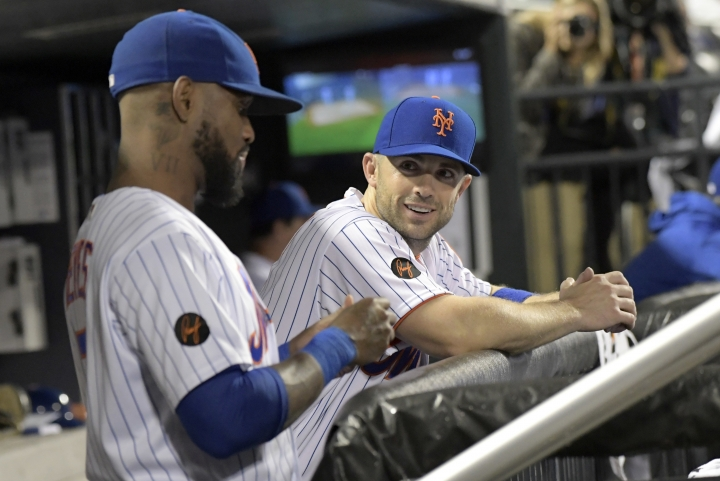 New York Mets' David Wright talks with Jose Reyes, left, during the seventh inning of the team's baseball game against the Atlanta Braves on Tuesday, Sept. 25, 2018, in New York. (AP Photo/Bill Kostroun)