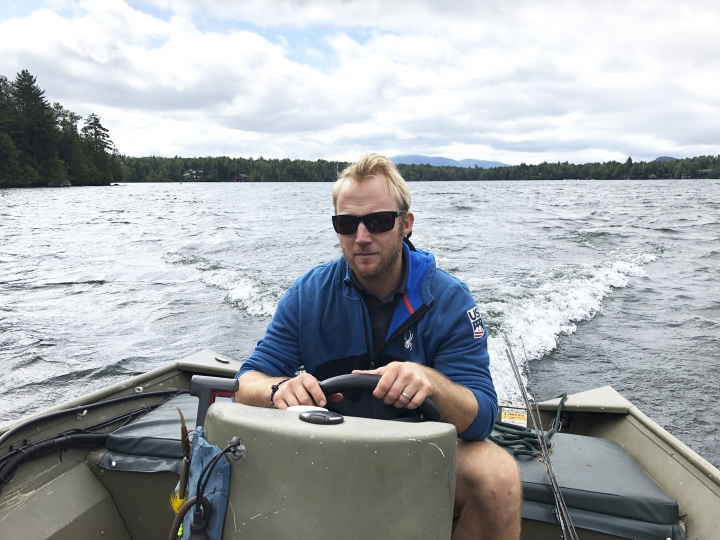 "In this Sept. 1, 2018, photo, Andrew Weibrecht, aka ""War Horse,"" pilots his boat on Lake Placid in the Adirondack Mountains of New York. The two-time Olympic medalist in downhill skiing retired in May at age 32 to spend more time with his young family and learn the family business. His parents operate the Mirror Lake Inn, one of the signature resorts in the East. (AP Photo/John Kekis)"
