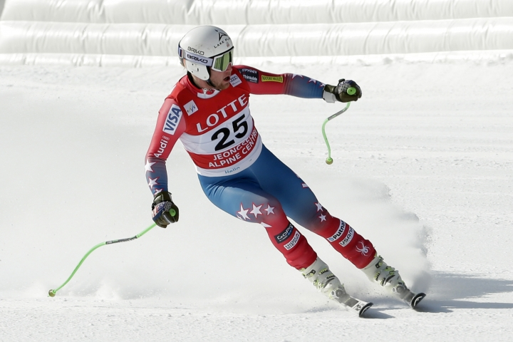 FILE - In this Feb. 6, 2016, file photo, Andrew Weibrecht crosses the finish line during a men's World Cup downhill race, a test event for the Pyeongchang 2018 Winter Olympics, in Jeongseon, South Korea. The two-time Olympic medalist in downhill skiing is forging a new life since he retired in May. He's back in college to complete his undergraduate degree, learning the ropes of the family business, the Mirror Lake Inn in Lake Placid, and, most importantly, spending more time with his wife and two young children. (AP Photo/Mark Schiefelbein, file)