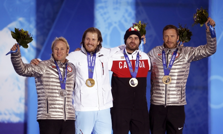 FILE - In this Feb. 16, 2014 file photo, men's super-G medalists, from left; United States' Andrew Weibrecht, silver, Norway's Kjetil Jansrud, gold, and Canada's Jan Hudec and the United States' Bode Miller, who tied for the bronze, pose with their medals at the 2014 Winter Olympics in Sochi, Russia. Weibrecht, a two-time Olympic medalist in downhill skiing, is forging a new life since he retired in May. He's back in college to complete his undergraduate degree, learning the ropes of the family business, the Mirror Lake Inn in Lake Placid, and, most importantly, spending more time with his wife and two young children. (AP Photo/Morry Gash, File)