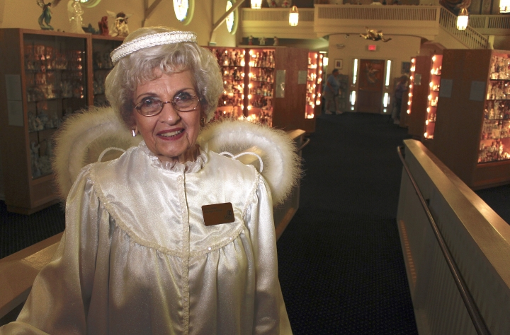 In this Sept. 13, 2018, photo, Joyce Berg stands in The Angel Museum in Beloit, Wis. The museum's final day will be Saturday, Sept. 29, 2018. Berg and her late husband hold a Guinness World Record, with more than 13,000 angels. Berg, one of the museum's founders, said they are closing after 20 years due to insufficient funds, membership, sponsors and volunteers. (AP Photo/Carrie Antlfinger)