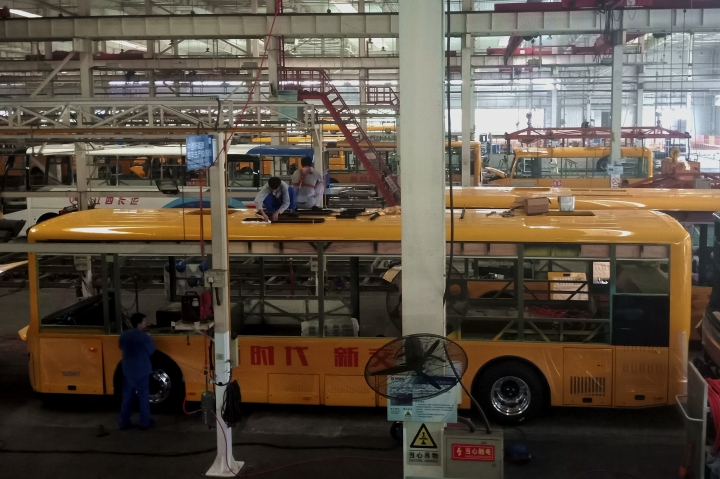 In this Wednesday, Aug. 22, 2018, photo, workers assemble electric buses at a factory in Liaocheng city in east China's Shandong province. China announced more tariff cuts Wednesday, Sept. 26 on construction machinery and other goods but no action on U.S. complaints about its technology policy that are fuelling an escalating trade battle. (Chinatopix Via AP)