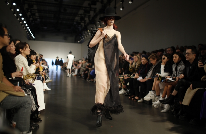 A model wears a creation as part of Maison Margiela Spring/Summer 2019 ready-to-wear fashion collection presented in Paris, Wednesday, Sept.26, 2018. (AP Photo/Thibault Camus)
