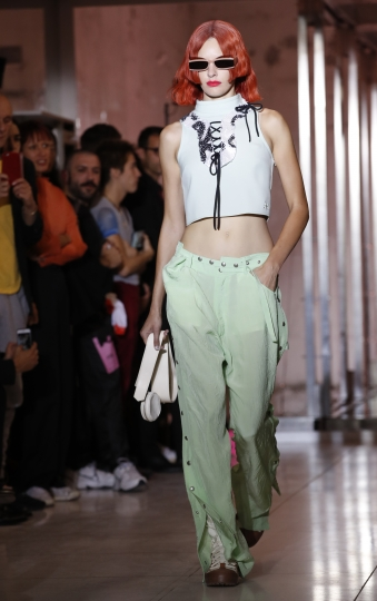 A model wears a creation for the Courreges Spring/Summer 2019 ready to wear fashion collection presented in Paris, Wednesday, Sept. 26, 2018. (AP Photo/Christophe Ena)