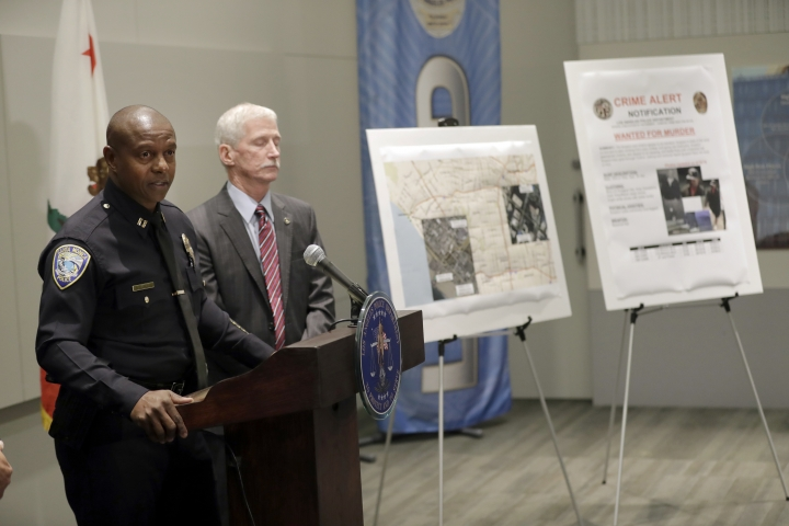 Santa Monica PD Capt. Wendell Shirley, left, speaks at LAPD headquarters Tuesday, Sept. 25, 2018, in Los Angeles. A man arrested on suspicion of beating a Southern California homeless man into unconsciousness and suspected in six other attacks — three of them fatal — also was being investigated in the disappearances of two of the suspect's Texas relatives, officials said Tuesday. (AP Photo/Marcio Jose Sanchez)