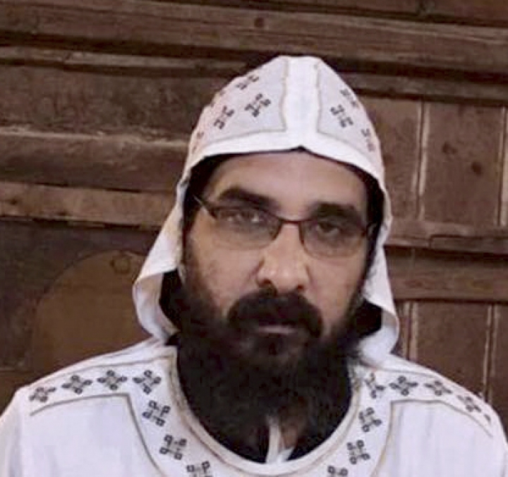 FILE - This undated file photo released by the Coptic Orthodox Church, shows Coptic monk Zeinoun al-Maqari, in Egypt. Security officials said an autopsy on al-Maqari who had until recently belonged to a monastery where the abbot was killed showed clear signs of poisoning. Speaking on Thursday, Sept. 27, 2018, they said the autopsy was performed late Wednesday, hours after the monk was pronounced dead on arrival at a hospital at the southern city of Assiut. Two monks, one defrocked, are on trial for the killing. (Coptic Orthodox Church via AP, File)