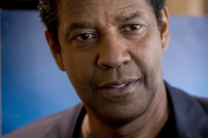 Actor Denzel Washington smiles following an interview with Malachi Haynes and Fox News Anchor Chris Wallace at the National Press Club in Washington, Wednesday, Sept. 26, 2018. Boys & Girls Clubs of America has named Malachi Haynes the Southwest Youth of the Year. (AP Photo/Andrew Harnik)