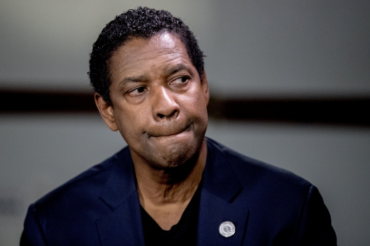 Actor Denzel Washington sits for an interview with Malachi Haynes and Fox News Anchor Chris Wallace at the National Press Club in Washington, Wednesday, Sept. 26, 2018. Boys & Girls Clubs of America has named Malachi Haynes the Southwest Youth of the Year. (AP Photo/Andrew Harnik)