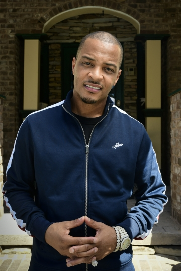 This Sept. 14, 2018 photo shows rapper Clifford Harris Jr., better known as T.I., posing in front of his grandparents' home in Atlanta. The rapper is paying homage to the trap music culture with its own museum dedicating areas of the exhibit to rappers including himself, Gucci Mane, Jeezy, Rick Ross and Future. The Trap Music Museum opens on Sept. 30. Trap is a popular sub genre of hip-hop with the term trap referring to places where drug deals take place. (AP Photo/John Amis)