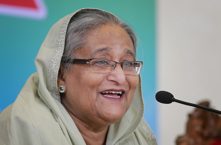 FILE- An Oct. 7, 2017 file photo of Bangladesh's Prime Minister Sheikh Hasina in Dhaka, Bangladesh. Journalists and human rights groups are demanding major amendments to a new law passed in Bangladesh Parliament in September, 2018, saying the law will choke constitutional rights of freedom of speech and expression. Hasina, who political opponents decry as an autocrat, defended the controversial bill in Parliament, saying that it was meant to protect the country's 162 million people. (AP Photo/A.M. Ahad, File)