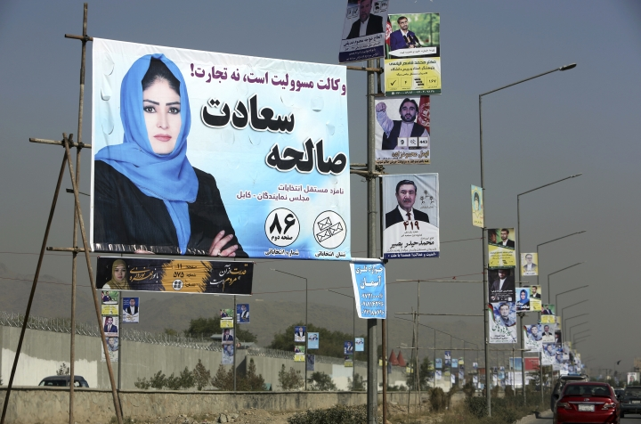 Campaign posters for Afghanistan's upcoming parliamentary elections are displayed over a street during the first day of elections campaign in Kabul, Afghanistan, Friday, Sept. 28, 2018. An Afghan official says that Afghan parliamentarian candidates have started their campaigning across the country for the upcoming election scheduled for Oct. 20. (AP Photo/Rahmat Gul)