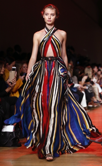 A model wears a creation for Elie Saab Spring/Summer 2019 ready-to-wear fashion collection presented in Paris, Saturday, Sept. 29, 2018. (AP Photo/Thibault Camus)