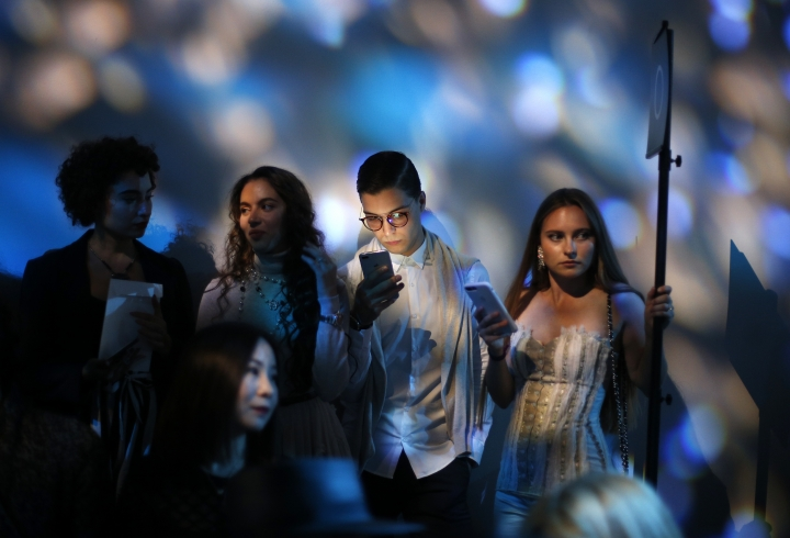Guests attend Elie Saab Spring/Summer 2019 ready-to-wear fashion collection presented in Paris, Saturday, Sept. 29, 2018. (AP Photo/Thibault Camus)