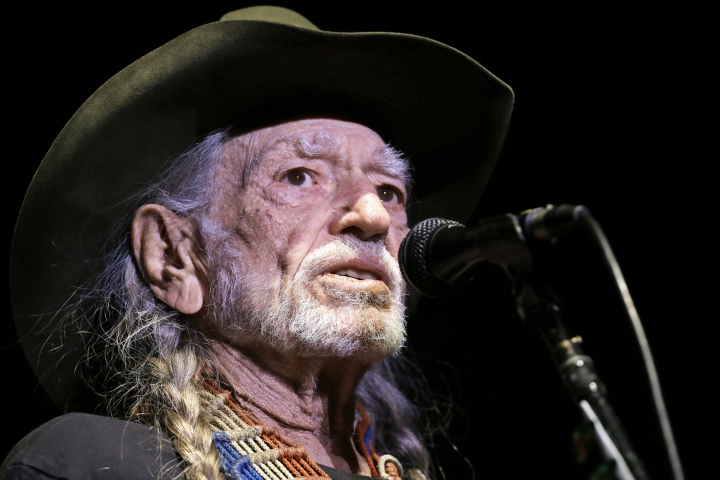 FILE - In this Jan. 7, 2017, file photo, Willie Nelson performs in Nashville, Tenn. Nelson will hold a concert for Democratic Senate candidate Beto O'Rourke on Saturday, Sept. 29, 2018. O'Rourke is a three-term congressman from El Paso trying to upset Republican Sen. Ted Cruz in November. (AP Photo/Mark Humphrey, File)