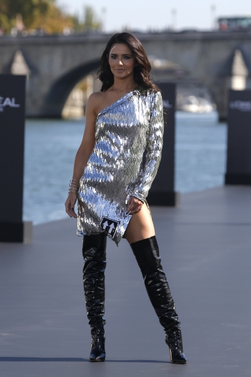 British singer Cheryl wears a creation for L'Oreal Spring/Summer 2019 ready-to-wear fashion collection presented in Paris, Sunday, Sept.30, 2018. (AP Photo/Michel Euler)