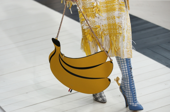 A model holds a banana-shaped handbag for Thom Browne Spring/Summer 2019 ready-to-wear fashion collection presented in Paris, Sunday, Sept.30, 2018. (AP Photo/Thibault Camus)