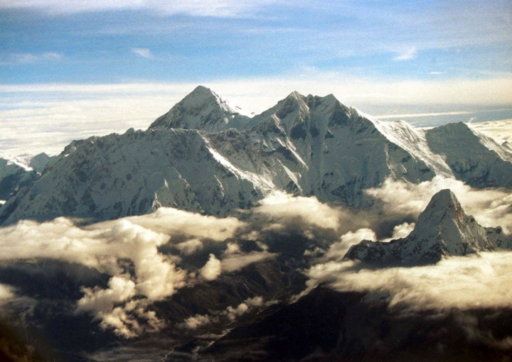 FILE - In this Aug. 26, 2000, file photo, the southern face of Mount Everest including Mount Lhotse, middle right, soars above the monsoon clouds at the border of Nepal and Tibet. Pemba Sherpa of the Xtreme Climbers Treks and Expeditions says American climbers James Morrison and Hilaree Nelson successfully skied down Mount Lhotse's 8,516-meter (27,940-foot) summit after scaling it on Sunday. (AP Photo/John McConnico, File)
