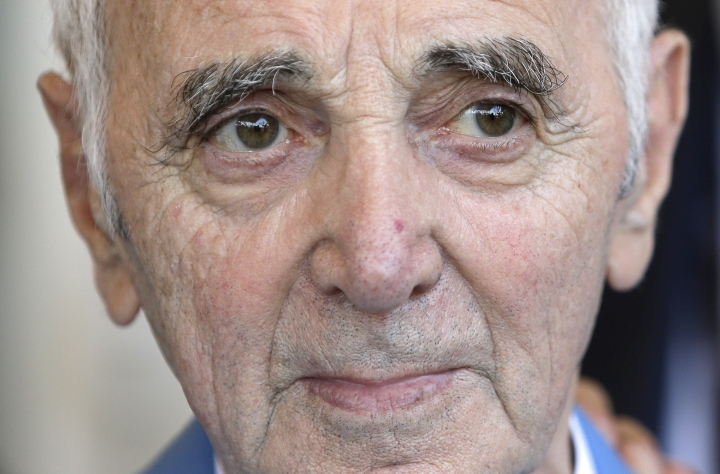FILE - In this June 6, 2015 file photo, French and Armenian singer, songwriter and actor, Charles Aznavour poses in Cannes, southeastern France. Charles Aznavour, the French crooner and actor whose performing career spanned eight decades, has died. He was 94. (AP Photo/Lionel Cironneau, File)