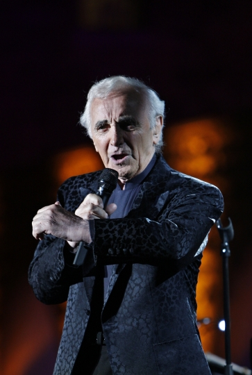 FILE - In this July 9, 2009 file photo, French singer Charles Aznavour performs during a concert at the annual Beiteddine cultural festival in the central Chouf mountains east of Beirut, Lebanon. Charles Aznavour, the French crooner and actor whose performing career spanned eight decades, has died. He was 94. (AP Photo/Bilal Hussein, File)