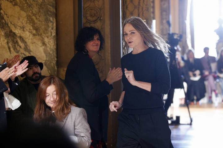 Fashion designer Stella McCartney accepts applauses after the presentation of her Spring/Summer 2019 ready-to-wear fashion collection in Paris, Monday, Oct.1, 2018. (AP Photo/Thibault Camus)