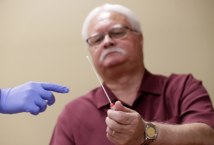 "Larry Rebenack, 71, finishes his gene testing procedure Tuesday, Aug. 14, 2018 at Banner Alzheimers Institute in Phoenix. ""I have a lot of friends and acquaintances I've seen deteriorate,"" including one who started blowing through stop signs on a route to a golf course they had safely traveled for years, and another who forgot not only where he had parked his car but even what kind of car it was, Rebenack said. ""It's a disease that takes a little part of you away each day."" (AP Photo/Matt York)"