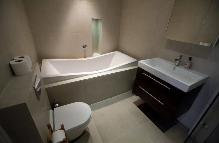 This Friday, Sept. 28, 2018, photo shows the bathroom of a flat that will be available for short term rent in London. Hotel companies are getting into the business of home-sharing. Marriott has been testing this in London in partnership with a home-sharing company called Hostmaker. (AP Photo/Kirsty Wigglesworth)