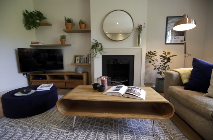 This Friday, Sept. 28, 2018, photo shows the living room of a flat that will be available for short term rent in London. Hotel companies are getting into the business of home-sharing. Marriott has been testing this in London in partnership with a home-sharing company called Hostmaker. (AP Photo/Kirsty Wigglesworth)