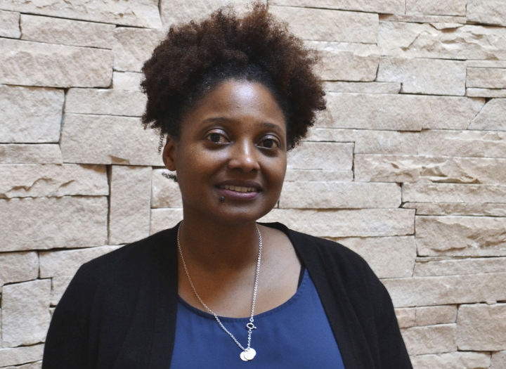 """FILE - In this Jan. 12, 2018, file photo, U.S. Poet Laureate Tracy K. Smith stands in a rotunda of the Santa Fe Indian School in Santa Fe, N.M. Smith, is launching a weekly podcast and radio program called """"The Slowdown."""" Smith said in a statement Tuesday, Oct. 2, that she wanted to inspire listeners to """"make a daily space for poetry"""" in a world dominated by breaking news events. (AP Photo/Mary Hudetz, File)"""