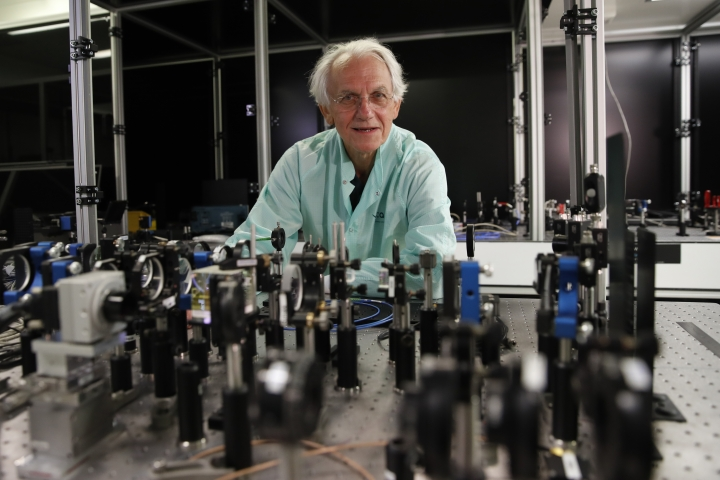 French scientist Gerard Mourou poses ion his laboratory at the Ecole Polytechnique in Palaiseau, south of Paris, Tuesday, Oct.2, 2018. Three scientists from the United States, Canada and France won the Nobel Prize in Physics on Tuesday for work with lasers described as revolutionary and bringing science fiction into reality. (AP Photo/Christophe Ena)