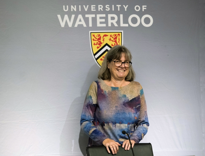 Noble Prize winner Donna Strickland smiles as she receives a standing ovation before speaking to the media during a press conference regarding her prestigious award in Waterloo, Ontario, on Tuesday, Oct. 2, 2018. Scientists from the United States, Canada and France won the Nobel Prize in physics Tuesday for revolutionizing the use of lasers in research, finding ways to make them deliver more powerful flashes of light and even to act like tiny tweezers. (Nathan Denette/The Canadian Press via AP)